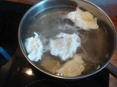 eggs poaching in simmering water