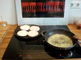 areapas and onions cooking