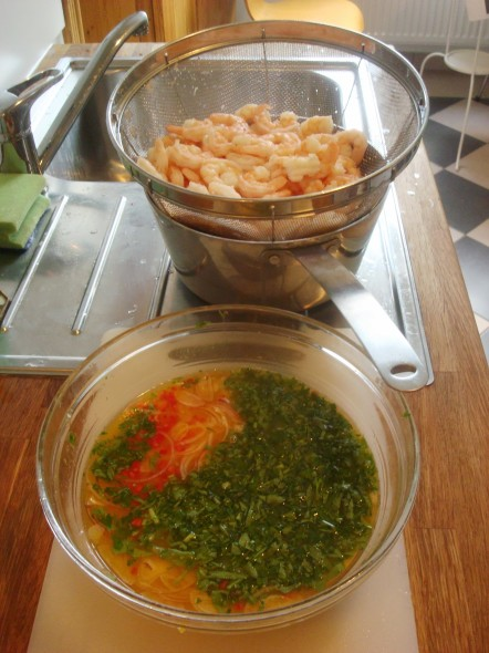 prawns ready to go into ceviche orange juice mix