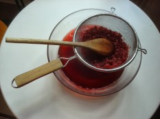 straining the infused vinegar