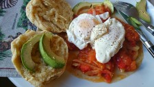 poached eggs, tomato sauce and Arepas Andinas with avocado