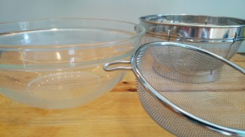 two sieves and a bowl