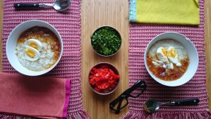 Congee with parsley, roasted diced peppers, soft boiled eggs and chicken broth jelly