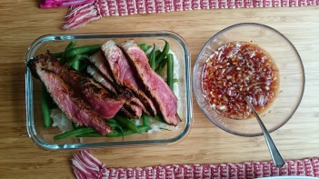 Steak and spicy sauce, steamed rice and green beans lunch-box