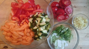 red peppers, carrots, courgette, tomatoes and green onions